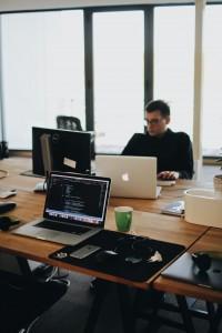 man-behind-computers